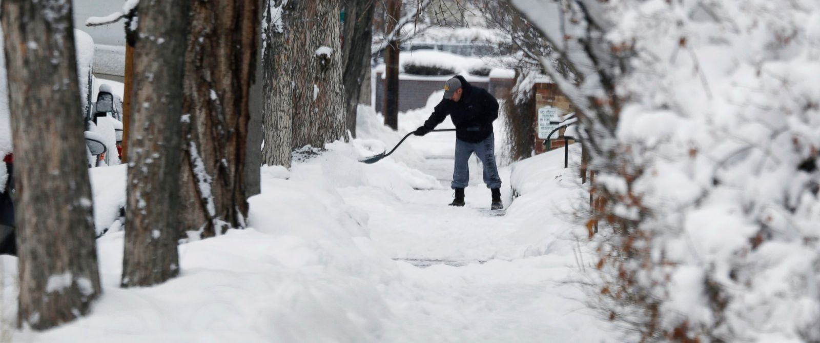 PHOTO: A shoveler toils on a sidewalk after a winter storm sent temperatures plunging to single-digit levels and dumped up to a foot of snow, Feb. 22, 2015, in Denver.