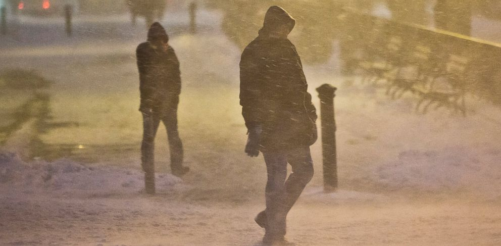 PHOTO: Pedestrians walk through wind-swept snow, Jan. 26, 2015, in Brooklyn, New York.