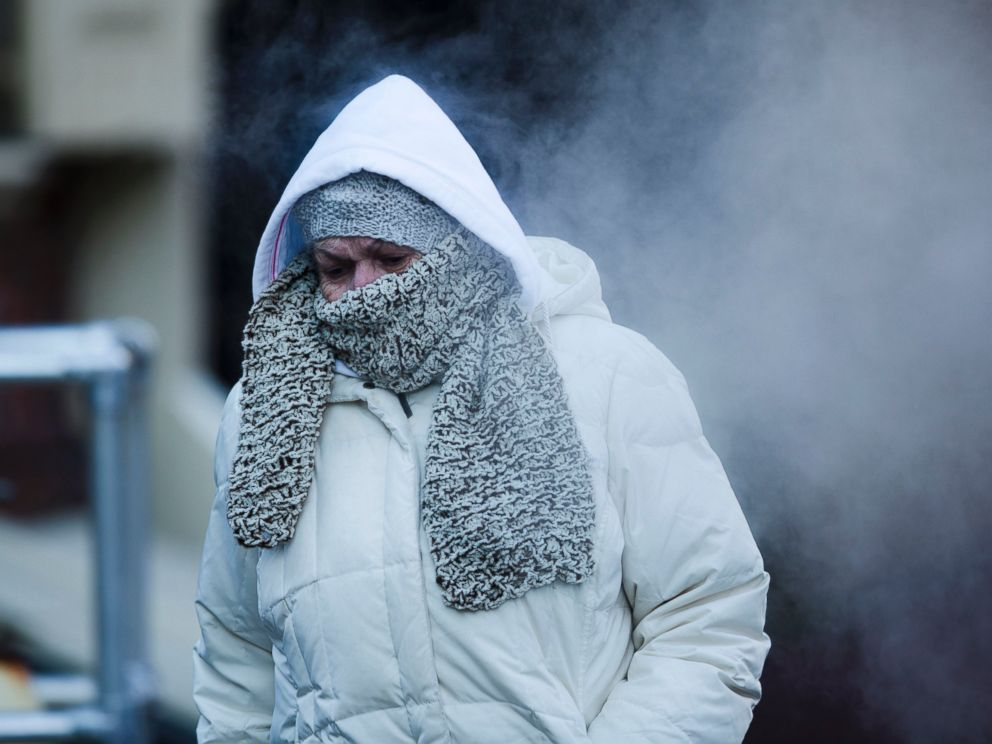 PHOTO: A commuter walks along Philadelphias Market Street in freezing temperatures, Nov. 18, 2014.