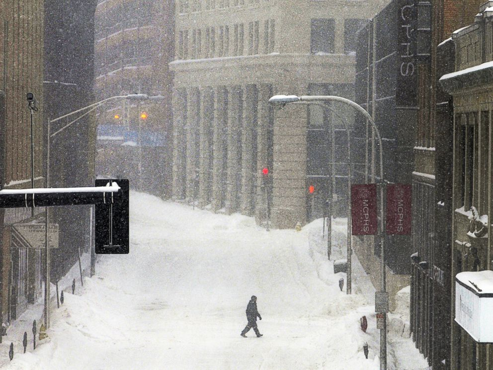 PHOTO: A single pedestrian crosses Mechanic Street during a snowstorm, Feb. 2, 2015, in downtown Worcester, Mass.