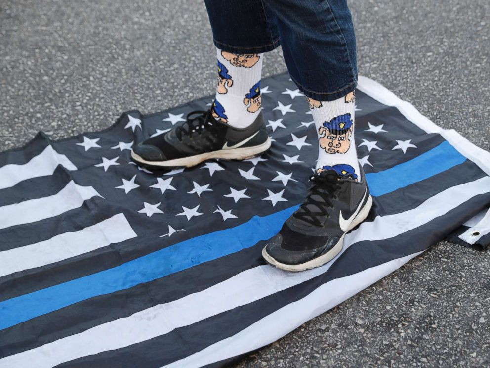 PHOTO: A protester steps on a flag Saturday, Sept. 16, 2017 in University City, Mo., in response to a not guilty verdict in the trial of former St. Louis Police officer Jason Stockley.