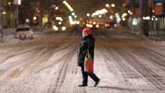 PHOTO: A woman crosses a mostly empty 42nd Street in Times Square, New York, Jan. 26, 2015.