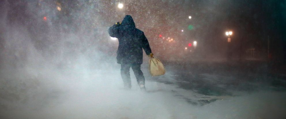 PHOTO: A man battles fierce headwinds as he walks through the snow on Congress Street in Portland, Maine, Jan 27, 2015.