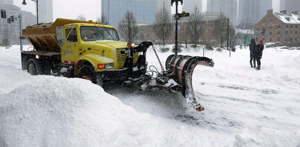 PHOTO: A snowplow clears a street near Quincy Market, Jan. 27, 2015, in Boston.