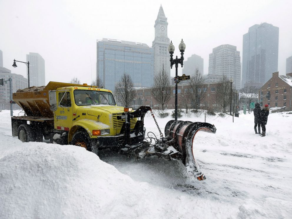 PHOTO: A snowplow clears a street near Quincy Market, Jan. 27, 2015, in Boston.