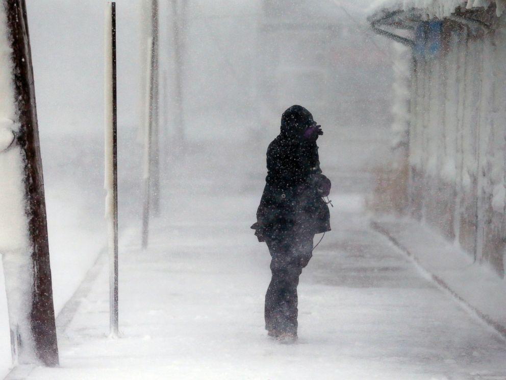 PHOTO: A woman braces against the wind during a winter storm in Marshfield, Mass., Jan. 27, 2015.