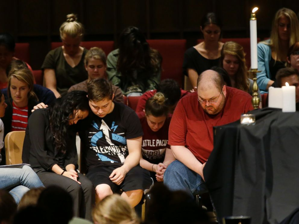 PHOTO: People bow their heads near a display of candles at a prayer service at First Free Methodist Church, June 5, 2014, on the campus of Seattle Pacific University in Seattle.