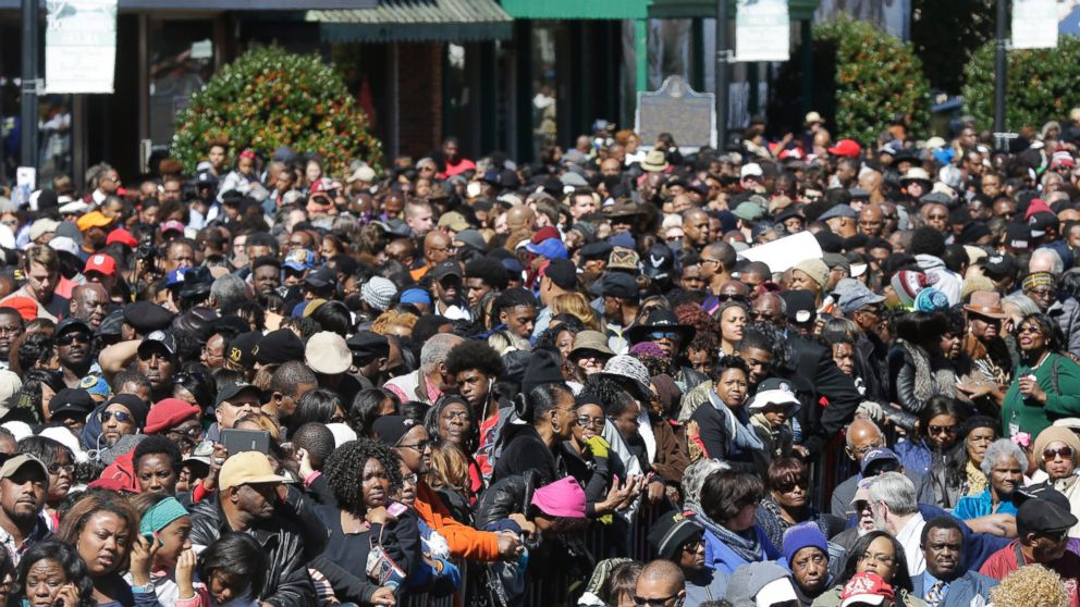 """A large crowd forms near a stage where President Barack Obama will speak and then take a symbolic walk across the Edmund Pettus Bridge, Saturday, March 7, 2015, in Selma, Ala. This weekend marks the 50th anniversary of """"Bloody Sunday."""""""
