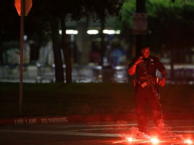 PHOTO: An armed police officer stands guard at a parking lot near the Curtis Culwell Center, May 3, 2015, in Garland, Texas.