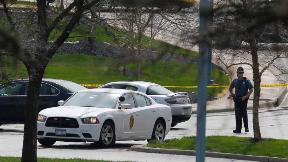 PHOTO: A Kansas State Trooper stands near the location of a shooting at the Jewish Community Center in Overland Park, Kan., April 13, 2014.