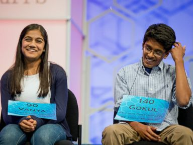 The remaining two spellers Vanya Shivashankar, 13, left, of Olathe, Kan., and Gokul Venkatachalam, 14, right, of St. Louis, sit on stage during the finals of the Scripps National Spelling Bee, Thursday, May 28, 2015, in Oxon Hill, Md.