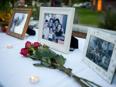 PHOTO: Flowers and photos are on display during a vigil for the Strack family at Pioneer Park in Provo, Utah, in this Oct. 2, 2014 file photo.