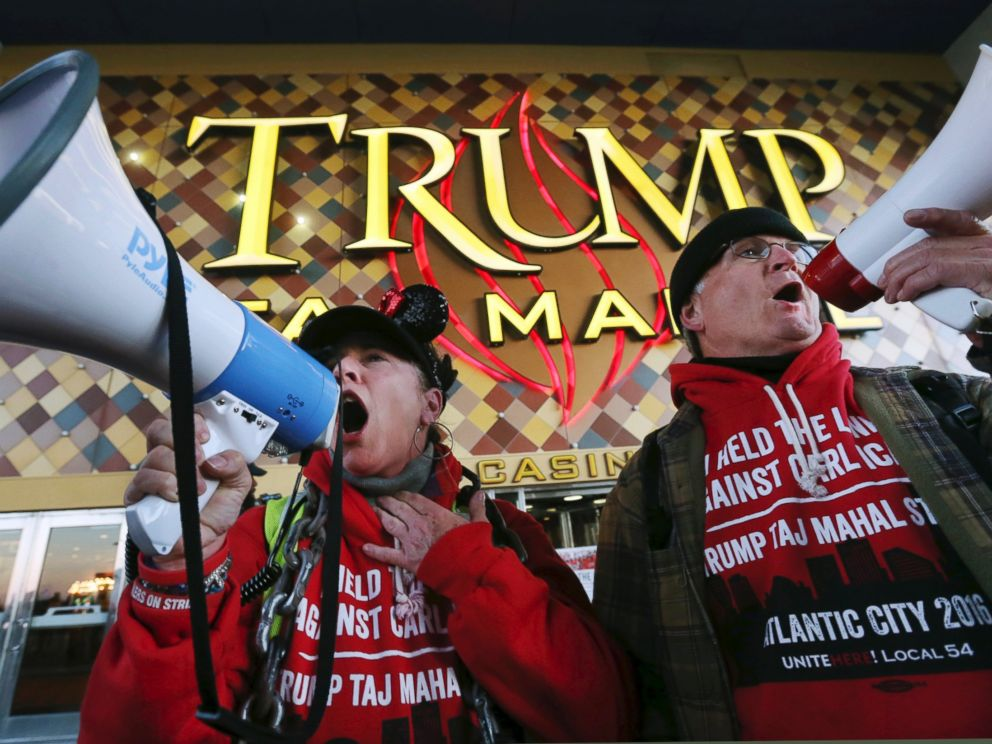 PHOTO: Members of Local 54 of the Unite-HERE union, Tina Condos, a cocktail waitress at Trump Taj Mahal and Keith Fullmer, a bartender, shout early in the morning outside the closing Trump Taj Mahal on Oct. 10, 2016, in Atlantic City, New Jersey.