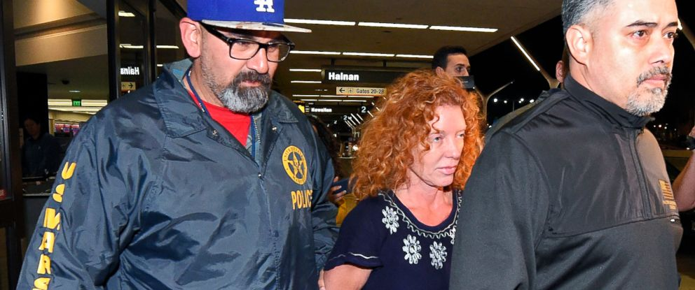 PHOTO:Tonya Couch, center, is taken by authorities to a waiting car after arriving at Los Angeles International Airport, Dec. 31, 2015, in Los Angeles.