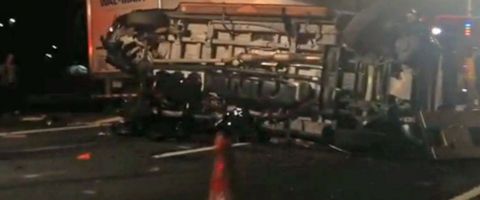 PHOTO: In this image from video the limousine bus carrying Tracy Morgan and six other people lies on its side early Saturday morning June 7, 2014 on the New Jersey Turnpike.