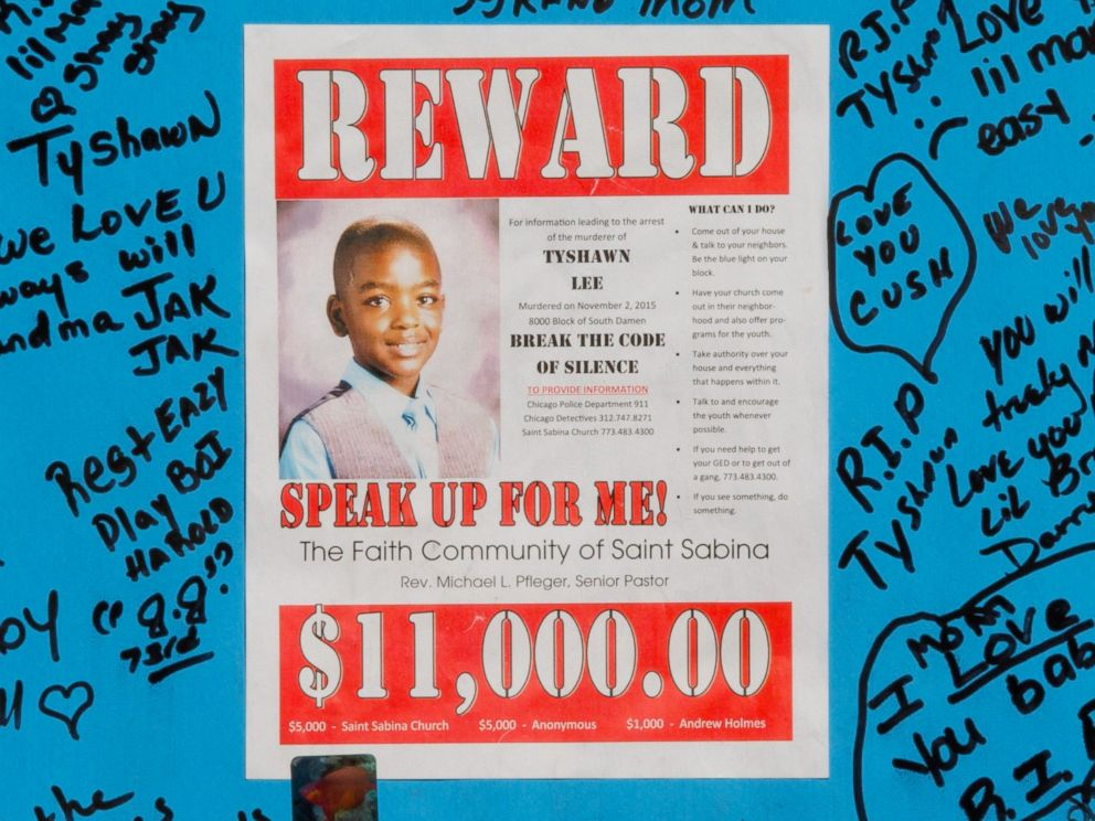 PHOTO: A reward sign and messages hang on Nov. 4, 2015, near where Tyshawn Lee was fatally shot in the Auburn Gresham neighborhood of Chicago.