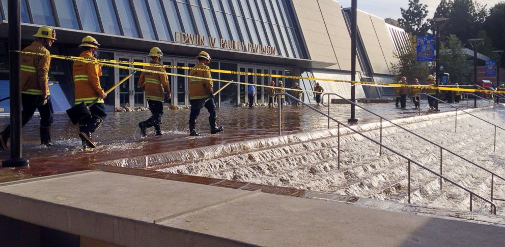 PHOTO: Water cascades down the stairs to a parking structure adjacent to the main entry doors of Pauley Pavilion, home of UCLA basketball, after a 30-inch water main burst July 29, 2014, in Los Angeles.