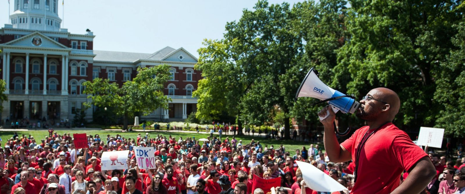 "PHOTO: Jonathan Butler uses a megaphone to encourage others to chant during a ""day of action"" demonstration celebrating graduate students on the University of Missouri campus in Columbia, Mo. on Aug. 26, 2015."
