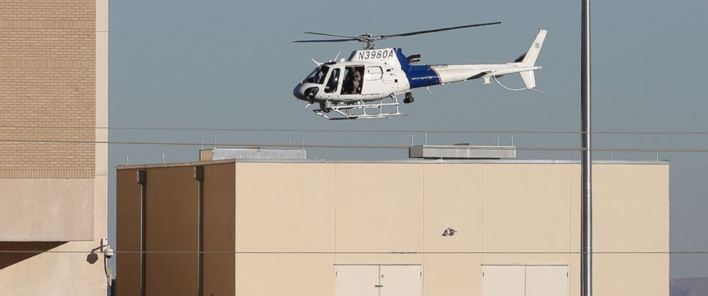 PHOTO: A Department of Homeland Security helicopter flies over the El Paso VA and Beaumont Army Medical Center campus during the search for a gunman in El Paso, Texas, Jan. 6, 2014.