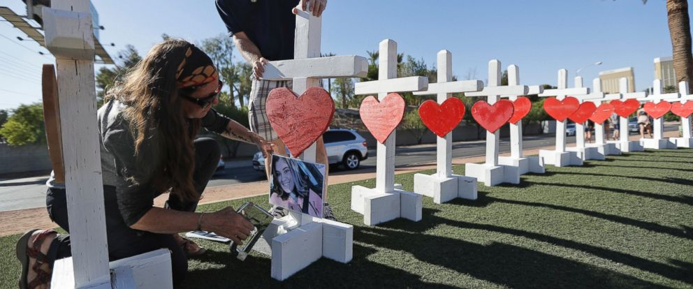 Sherri Camperchioli, left, and Jordan Cassel help set up some of the crosses that arrived in Las Vegas today to honor the victims of the mass shooting on Thursday, Oct. 5, 2017, in Las Vegas.