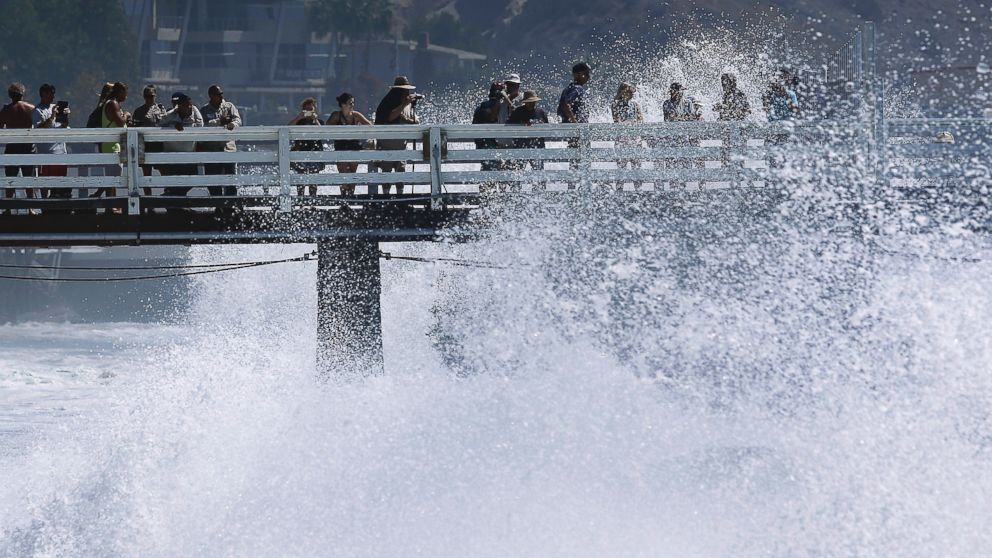 PHOTO: Surf watchers are splashed at the pier in Malibu, Calif., Aug. 27, 2014.