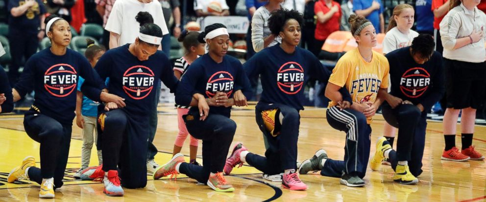 PHOTO: Members of the Indiana Fever kneel during the playing of the national anthem before the start of of a first round WNBA playoff basketball game, against the Phoenix Mercury, Wednesday, Sept. 21, 2016