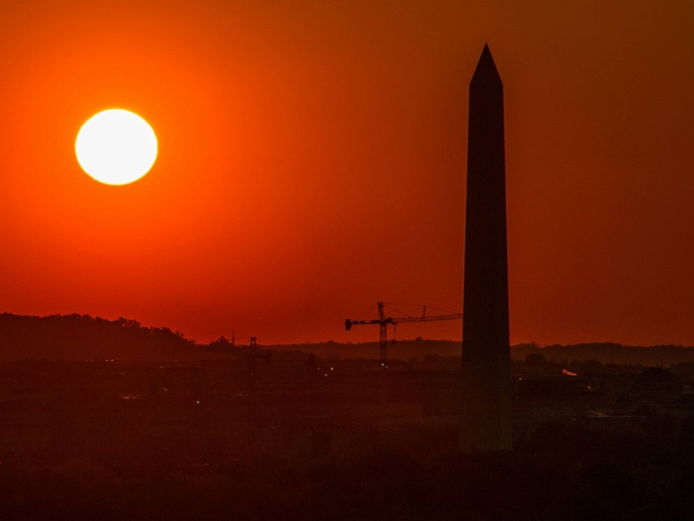 PHOTO: Sunrise behind the Washington Monument is seen from Arlington House in Arlington National Cemetery in Arlington, Va. May 4, 2014.