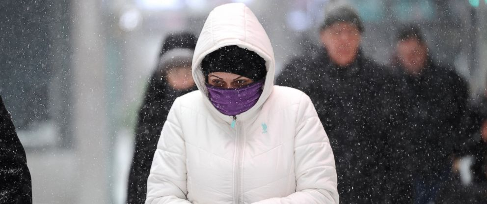 PHOTO: A woman wearing winter gear walks through Times Square during a snow storm on January 23, 2016.
