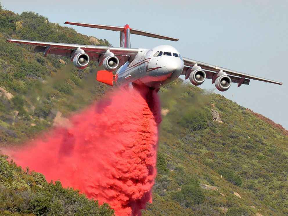 PHOTO: A British Aerospace BAe-146 belonging to Neptune Aviation makes a Phos-Chek drop, June 18, 2016, on wildfires in Santa Barbara County, Calif.