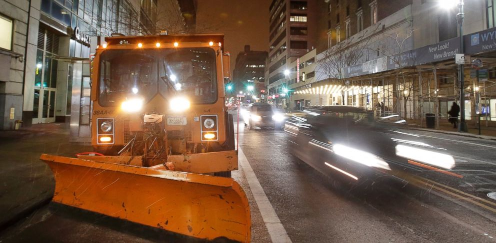PHOTO: A New York City snowplow, loaded with salt, sits parked in midtown Manhattan as light snow falls, Jan. 26, 2015.