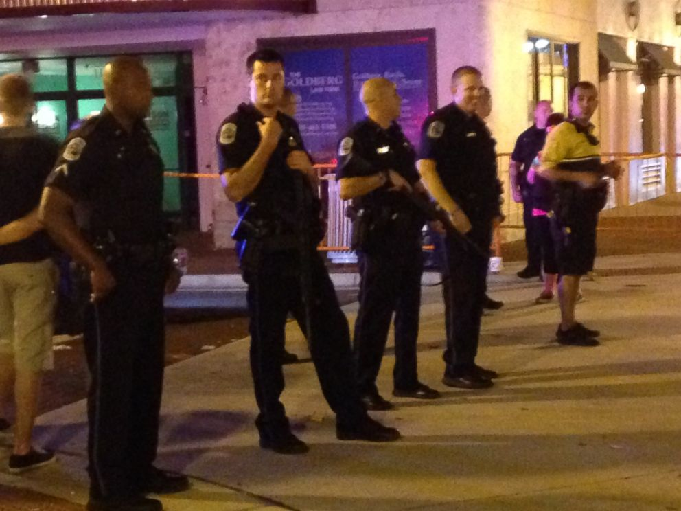 PHOTO: Police stand during the early morning, Oct. 18, 2015, near the site of a shooting at ZombiCon in Fort Myers Fla.