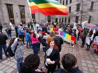 PHOTO: A woman holds a flag as she joins other gay marriage supporters in Linn Park, at the Jefferson County courthouse, Feb. 9, 2015, in Birmingham, Ala.