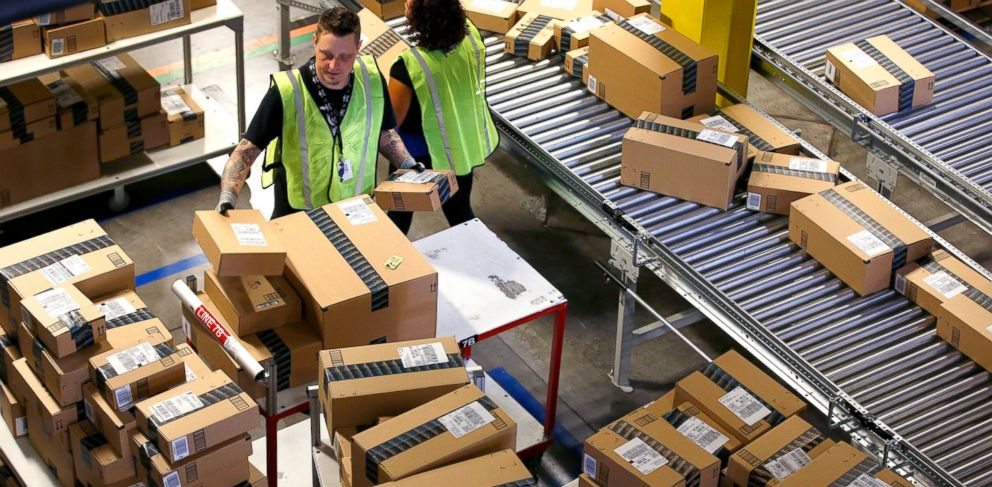 PHOTO: Amazon.com employees organize outbound packages at an Amazon.com Fulfillment Center, Dec. 2, 2013, in Phoenix.