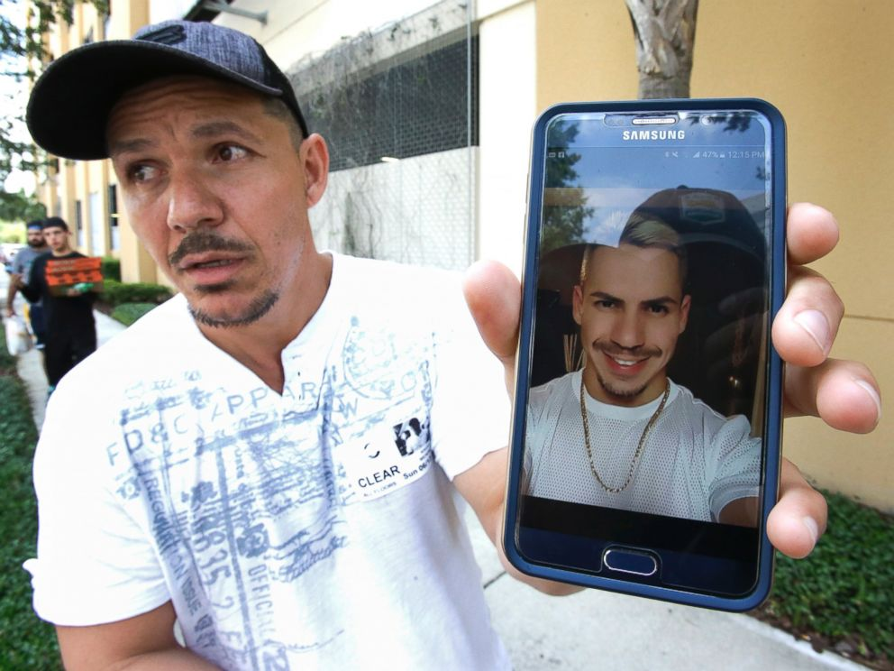 PHOTO: Angel Mendez holds up a cell phone photo trying to get information about his brother Jean C. Mendez that was at the Pulse Nightclub where a shooting involving multiple fatalities occurred, June 12, 2016, in Orlando, Fla.