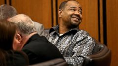 PHOTO: Anthony Lemons glances to family and friends at the Cuyahoga County Common Pleas Court
