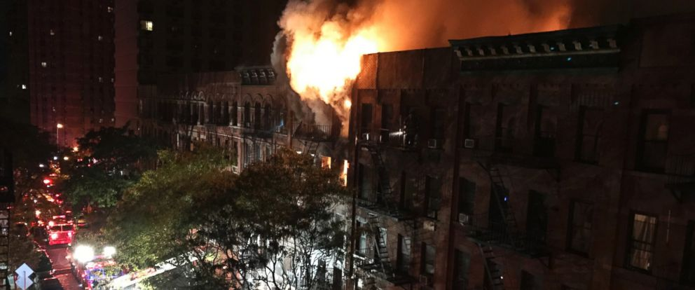 PHOTO: Firefighters work to put out a blaze at an apartment building on the Upper