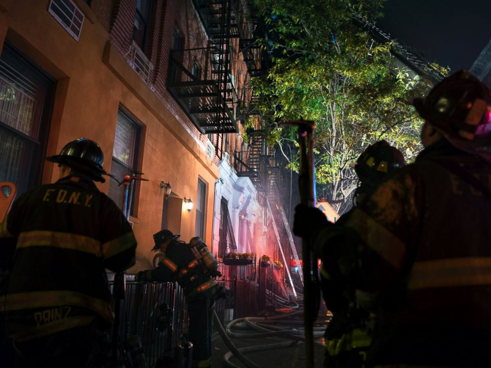 PHOTO: FDNY firefighters work at the scene of a fire at an apartment building on