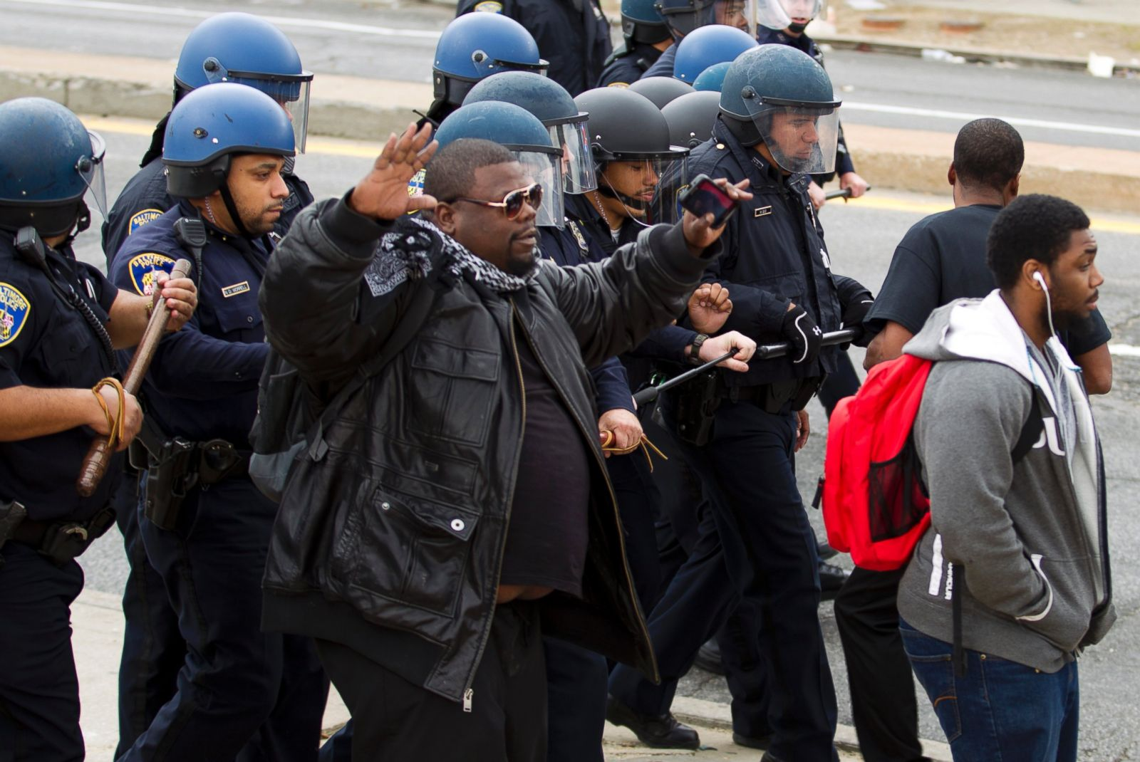 Baltimore police officers in riot gear push protestors back along - Baltimore Police Officers In Riot Gear Push Protestors Back Along 12