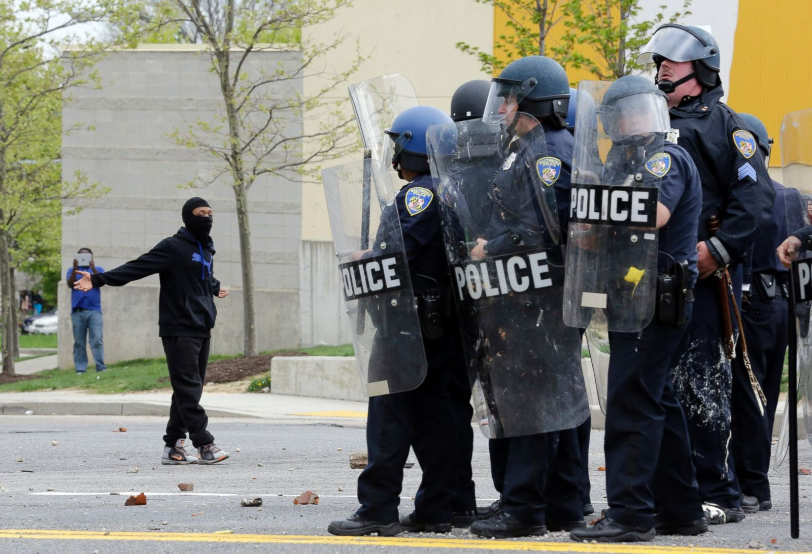Baltimore police officers in riot gear push protestors back along - Baltimore Police Officers In Riot Gear Push Protestors Back Along 16
