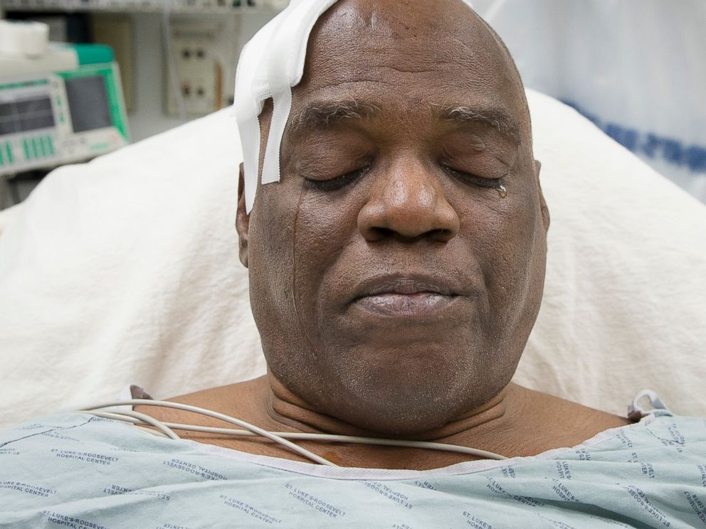 PHOTO: Cecil Williams cries during an interview as he rests in his hospital bed following a fall onto subway tracks from the platform at 145th Street, Dec. 17, 2013, in New York.