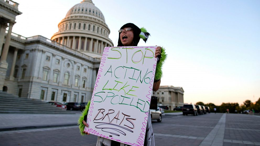 PHOTO: Janette Dunder of Alexandria, Va., protests outside the Capitol building as Congress continues the budget battle, Sept. 30, 2013, in Washington.