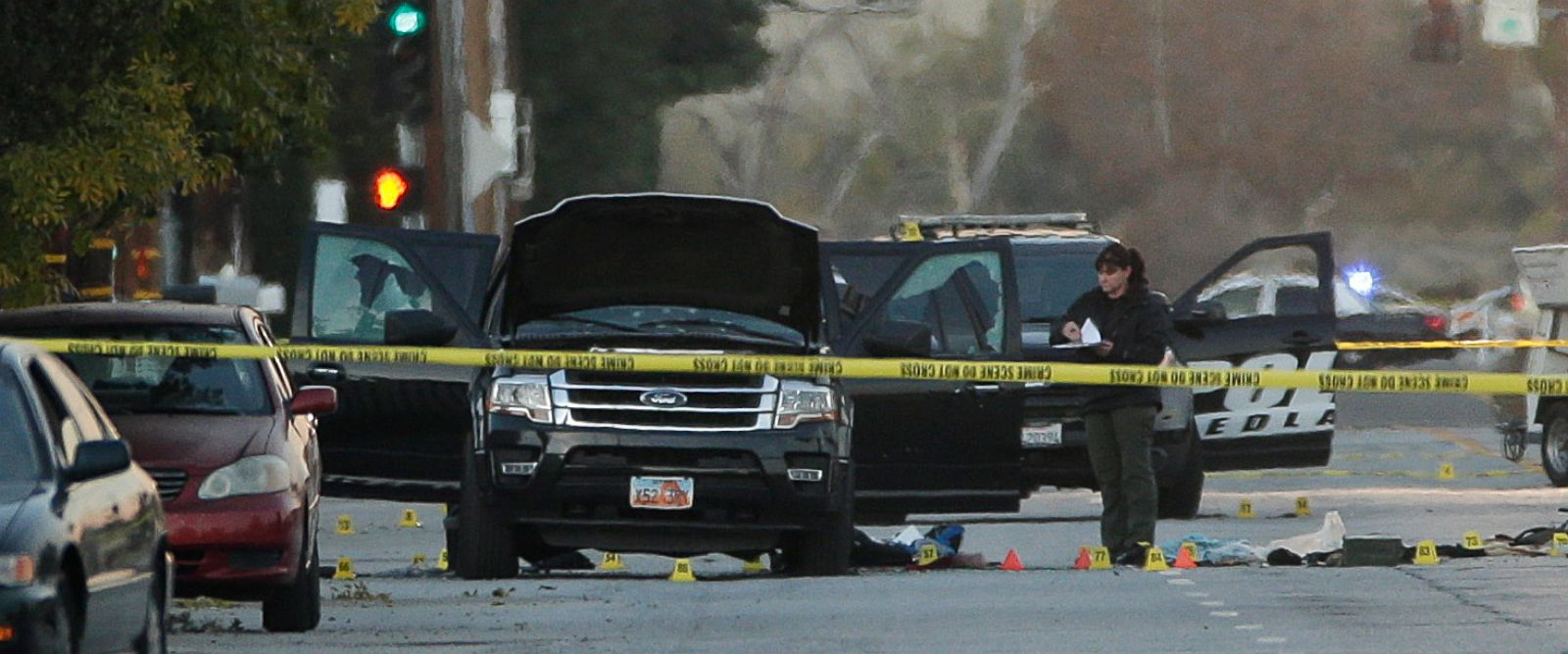 PHOTO: An investigator looks at a Black SUV that was involved in a police shootout with suspects, Dec. 3, 2015, in San Bernardino, Calif.