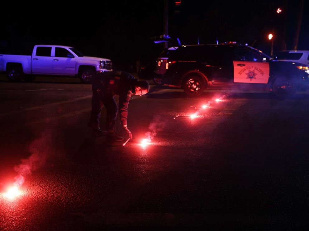 PHOTO: A police officer lights up flares near the scene where a shootout took place, Dec. 2, 2015, in San Bernardino, Calif.