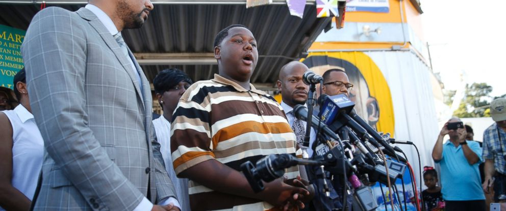 PHOTO: Cameron Sterling, center, son of Alton Sterling, who was killed by Baton Rouge police, speaks to the media outside the Triple S Food Mart, in Baton Rouge, La., July 13, 2016.