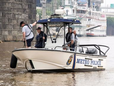 PHOTO: Authorities stand on a Louisville Metro Police Department boat, July 5, 2015, on the Ohio River in Louisville, Ky.