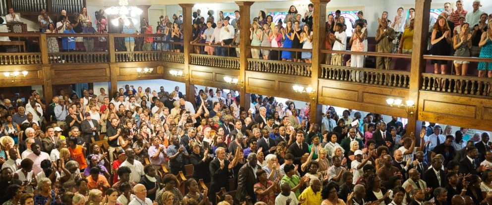 PHOTO: Parishioners applaud during a memorial service at Morris Brown AME Church for the people killed Wednesday during a prayer meeting inside a historic black church in Charleston, S.C., June 18, 2015.