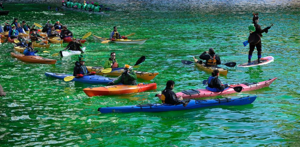 PHOTO: Kayakers float on the Chicago River after it was dyed green ahead of the St. Patricks Day parade in Chicago, Saturday, March 15, 2014.