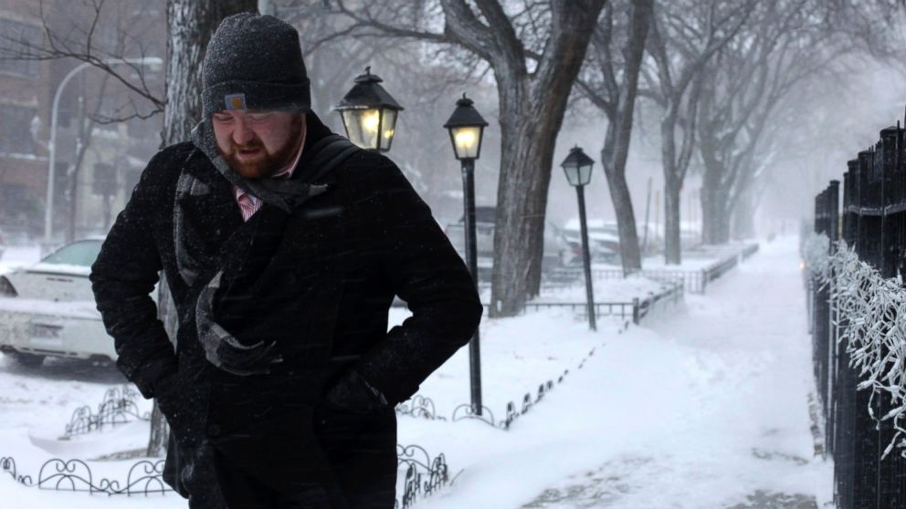 PHOTO: A morning commuter walks against blowing snow, Jan. 2, 201