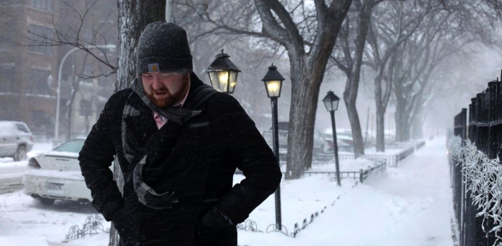 PHOTO: A morning commuter walks against blowing snow, Jan. 2, 2014, in Chicago.