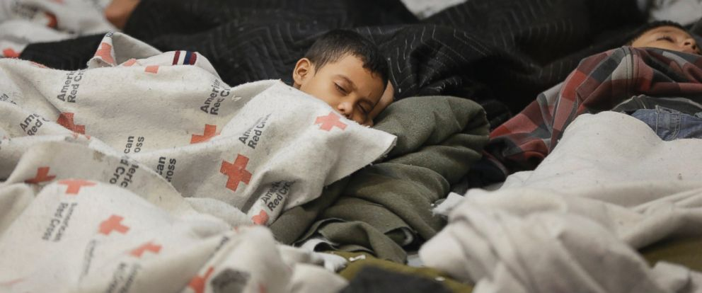 PHOTO: Detainees sleep in a holding cell at a U.S. Customs and Border Protection processing facility in Brownsville,Texas in this June 18, 2014 file photo.